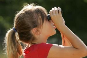 blonde-girl-watching-with-binoculars-725x483